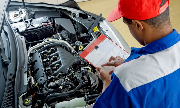 Mobile mechanic technician conducting a vehicle inspection.
