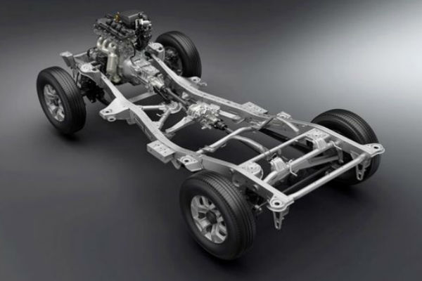 Photo of automobile without body to highlight the chassis and car parts that a mobile auto repair technician can fix.