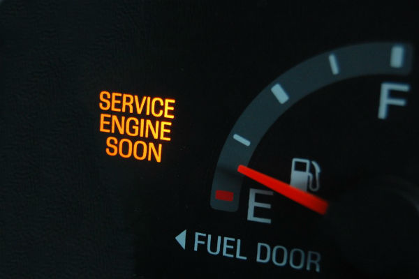 Photo of automobile Service Engine Soon warning light. Have a mobile mechanic make auto repair diagnostics for you.